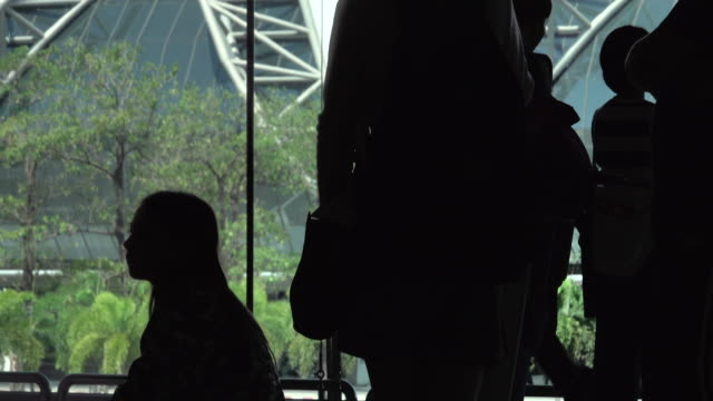 4k: People silhouette at airport travel with luggage