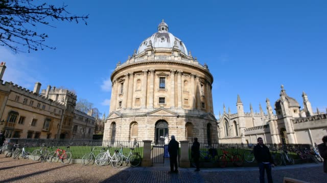 4k radcliffe camera, oxford university, england uk- time-lapse - oxford england stock videos and b-roll footage