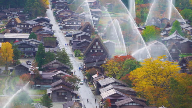 4k real time: water-discharge drill at shirakawago, gifu, japan. - sito patrimonio dell'umanità unesco video stock e b–roll