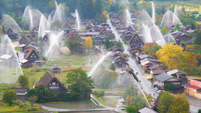 4k real time: water-discharge drill at shirakawago, gifu, japan. - sprinkler stock videos and b-roll footage