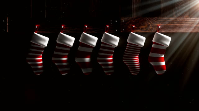 4k resolution 3d rendering red and white christmas socks overlay and background with travel matte - funny merry christmas greetings stock videos and b-roll footage