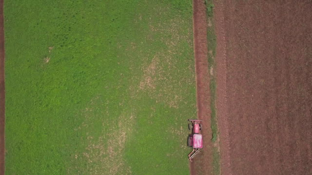 4k resolution aerial view of tractor plow agricultural field - agricultural equipment stock videos & royalty-free footage