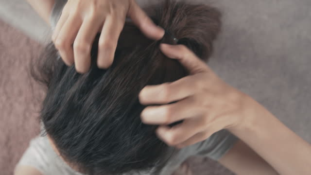 4k resolution asian woman itchy and scratching scalp damaged hair on her head. haircare concept - brown hair stock videos & royalty-free footage