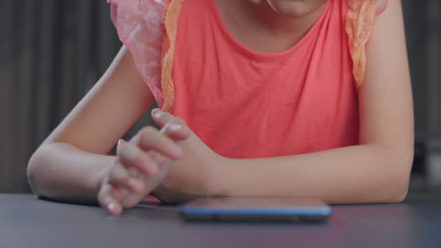 4k resolution attractive asian kid girl studying with her teacher e-learning on tablet screen with online homeschool while coronavirus or covid 19 lockdown situation. she having video call technology with her advice to learn her homework. - pencil isolated stock videos & royalty-free footage