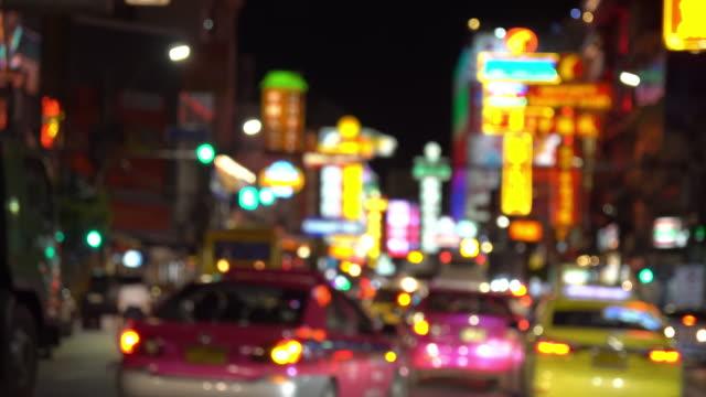4k resolution blurred night bangkok chinatown street - chinatown stock videos and b-roll footage