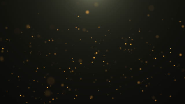 4k resolution christmas background, defocused gold colored particles on black background,slowly falling gold bokeh, glitter lights background, party-social events background, celebration events background, birthday events background,happy new year backgro - fascino video stock e b–roll