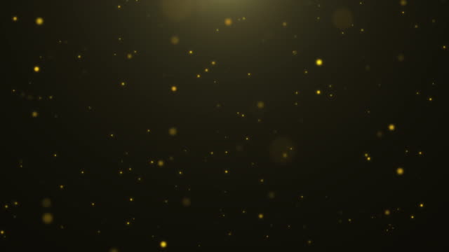 vídeos de stock e filmes b-roll de 4k resolution christmas background, defocused gold colored particles on black alpha layer background,slowly falling white bokeh, glitter lights background - dourado cores