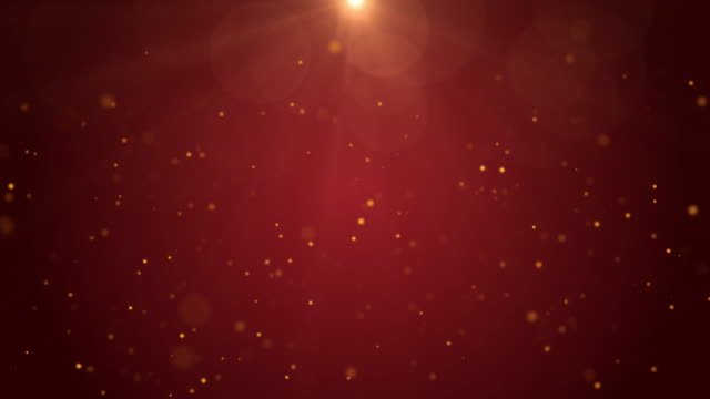 4k resolution christmas background, defocused gold colored particles on red background,slowly falling white bokeh, glitter lights background, - christmas lights stock videos & royalty-free footage