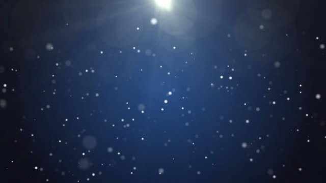 4k resolution christmas background, defocused particles on dark blue background,slowly falling white bokeh, glitter lights background - christmas lights stock videos & royalty-free footage