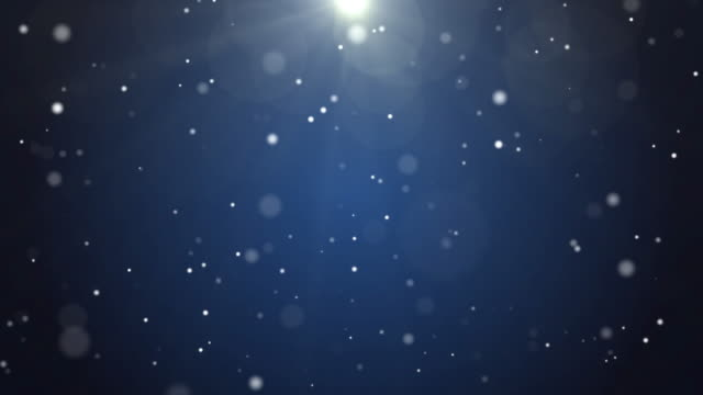 4k resolution christmas background, defocused particles on dark blue background,slowly falling white bokeh, glitter lights background - glittering stock videos & royalty-free footage