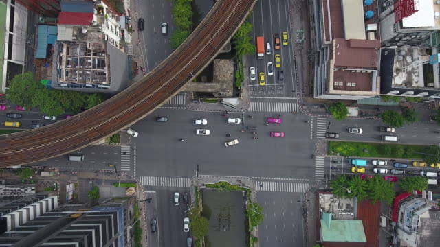 4k resolution cityscape ariel view intersection and traffic in central business district of bangkok city thailand - bangkok stock videos & royalty-free footage