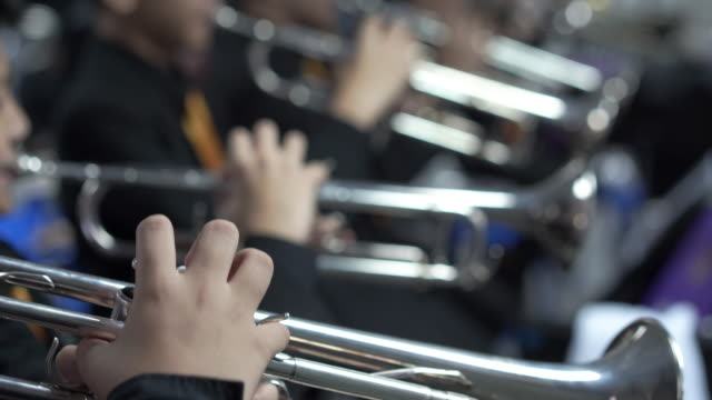 4k resolution close up hand of trumpet section in wind band - musician stock videos & royalty-free footage