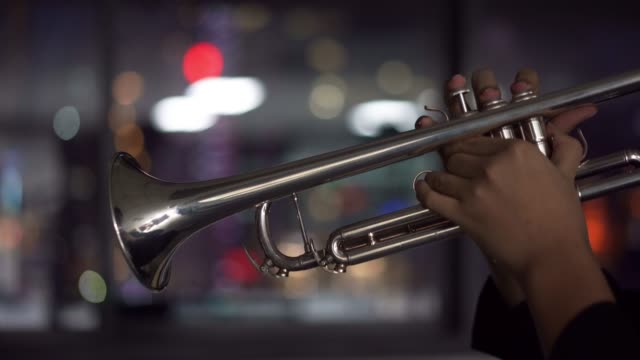4k resolution Close up Trumpet player in the dark