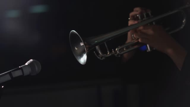 4k resolution close up trumpet player in the dark - trumpet stock videos & royalty-free footage