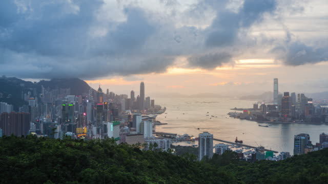 4k resolution day to night time lapse of hong kong city - victoria harbour hong kong stock videos & royalty-free footage