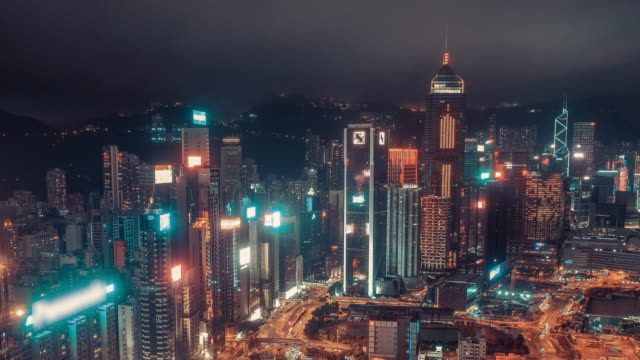 4k resolution drone point of view hyper lapse of hong kong city,aerial view of crossroad at night.hong kong traffic and transportation concept - hong kong stock videos & royalty-free footage