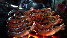 4k resolution: Fresh grilled shrimp on a hot stove for a night party