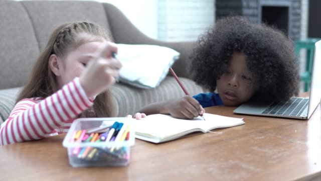 4k resolution multicultural little girl painting together on a book - glue stock videos and b-roll footage
