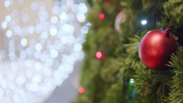 4k resolution of christmas tree lighting decoration .new year - christmas tree lighting ceremony stock videos & royalty-free footage