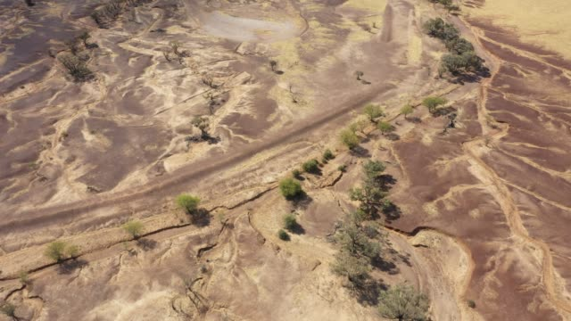 4k resolution of moving drone video over dry, drought pastures showing the  patterns of dry water channels outback australia - australia stock videos & royalty-free footage