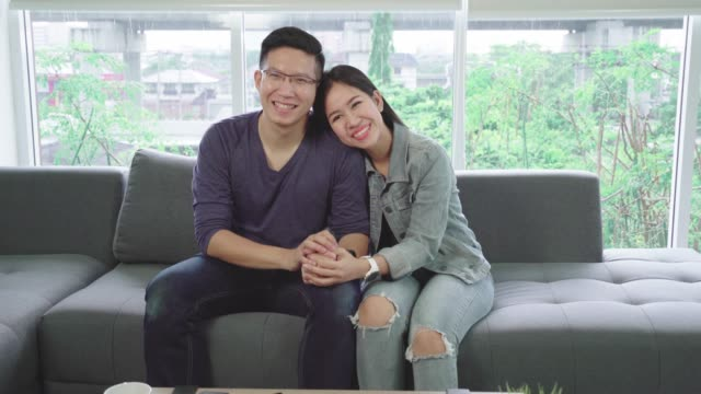 4k resolution sweet lovely asian couple relaxing together at home - coniugi video stock e b–roll