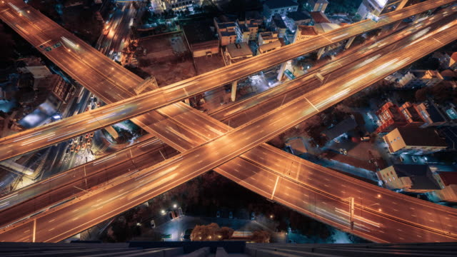 4k resolution Time lapse aerial view of cross road with light of traffic
