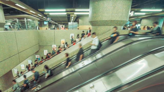 4k resolution time lapse crowd of people on escalator at train station in rush hour,commuters going home from work at hong kong station - conformity stock videos & royalty-free footage