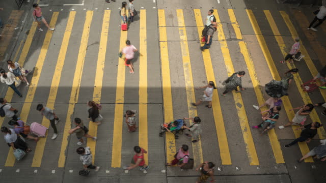 4k resolution time lapse crowd of people walking walking the zebra crossing road ,busy pedestrian at hong kong - conformity stock videos & royalty-free footage