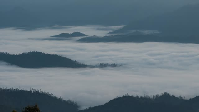 4k resolution time lapse of  foggy morning with wave of cloud in mountains at huai nam dang national park ,chiangmai province in north of thailand - annapurna range stock videos and b-roll footage
