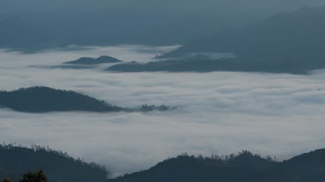 4k resolution Time lapse of  Foggy morning with wave of cloud in mountains at Huai Nam Dang National Park ,Chiangmai Province in north of thailand