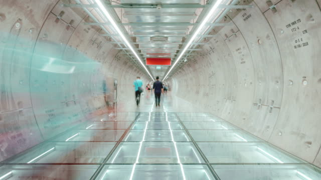 4k resolution time lapse pedestrian modern tunnel,crowd commuters walking subway station.technology and transportation concept,asian city life concept - futuristic stock videos & royalty-free footage