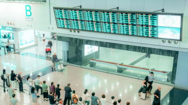 4k resolution time-lapse traveler crowd at airport departure halll,hong kong international airport airport - airport check in counter stock videos & royalty-free footage
