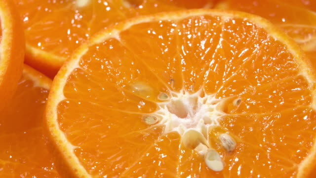 4k rotate of slice orange pattern. - orange colour stock videos & royalty-free footage