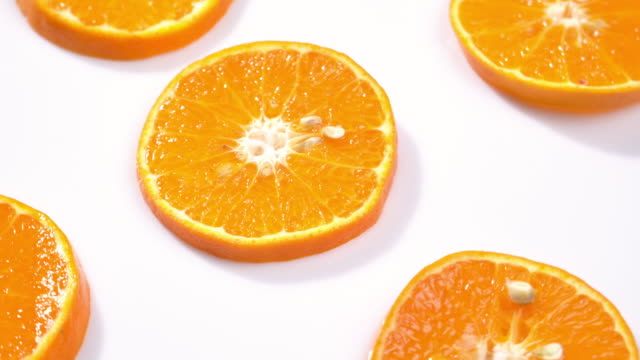 4k rotate of slice orange pattern. - ascorbic acid stock videos & royalty-free footage