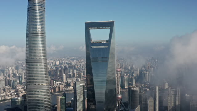 4k : shanghai financial district in fog - shanghai world financial center stock videos & royalty-free footage