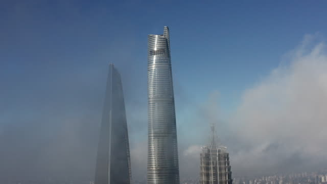 4k : shanghai financial district in fog - east china stock videos & royalty-free footage