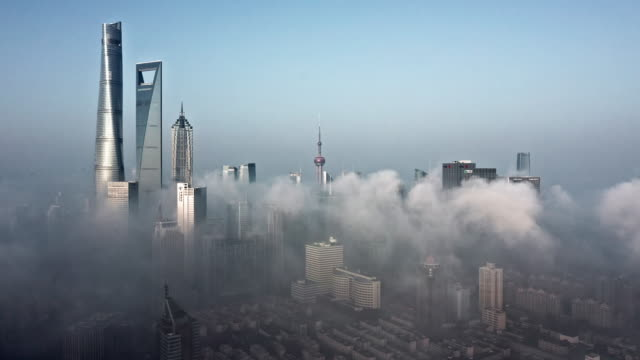 4k : shanghai financial district in fog - china east asia stock videos & royalty-free footage