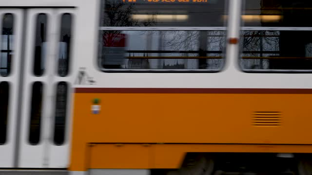 4k shot of famous city yellow tram transportation train in budapest hungary - hungary stock videos & royalty-free footage