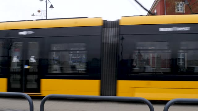 4k shot of famous city yellow tram transportation train in budapest hungary - széchenyi chain bridge stock videos & royalty-free footage