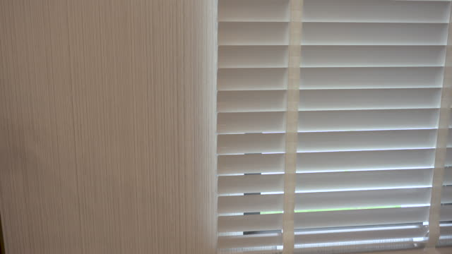 4k shot of open and close pvc white curtain - tapparella video stock e b–roll