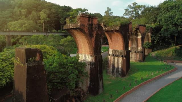 4k shot of ruins of long-teng bridge, miaoli county, taiwan - electricity pylon stock videos & royalty-free footage