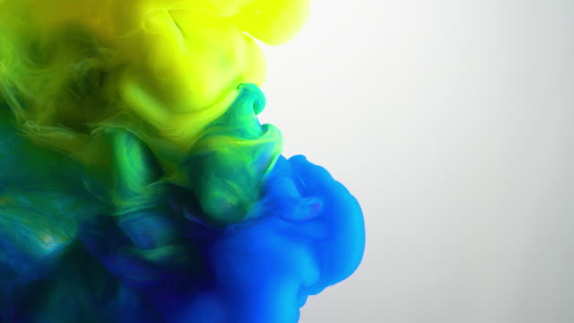 4k slow motion blue and yellow ink flow in water. - yellow stock videos & royalty-free footage