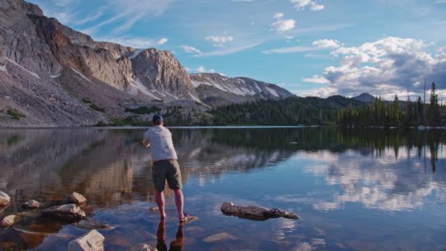 4k Slow Motion Fly Fishing inMountain Lake at Sunrise