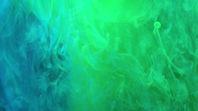 4k slow motion of coloured smoke. - green colour stock videos & royalty-free footage