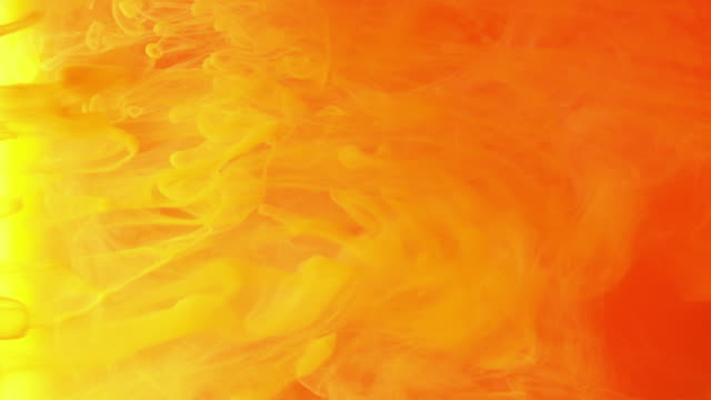 4k slow motion of coloured smoke. - orange colour stock videos & royalty-free footage