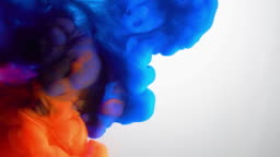 4k slow motion red and blue ink flow in water.