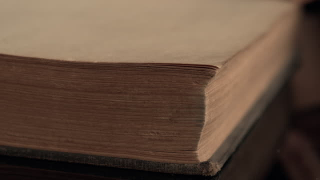4k slow motion turning the pages of an old book - old book stock videos and b-roll footage
