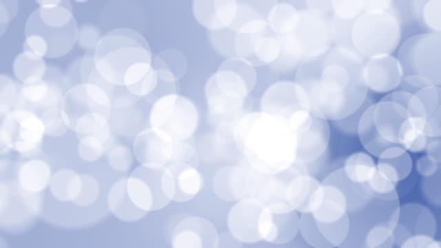 青い背景に4kソフトボケライト - カラーグラデーション点の映像素材/bロール