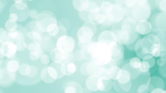 シアンの背景に4kソフトボケライト - カラーグラデーション点の映像素材/bロール