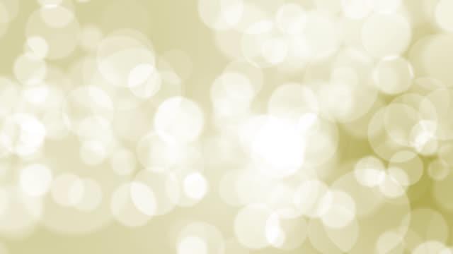 金の背景に4kソフトボケライト - カラーグラデーション点の映像素材/bロール